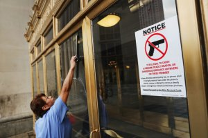 A sign on a door forbids folks from holding weapons into a public building in Cleveland, Ohio. Around 50,000 people are expected in Cleveland, including hundreds of protesters and people in the news. The four-day Republican nationwide Convention kicks off on July 18. Spencer Platt/Getty graphics